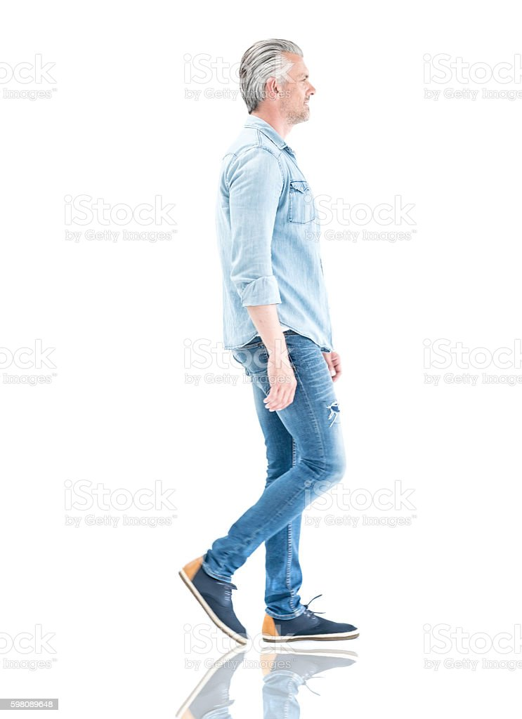 Casual man walking to the side stock photo