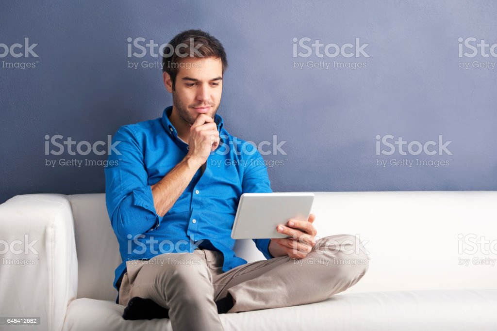 Casual man with digital tablet stock photo