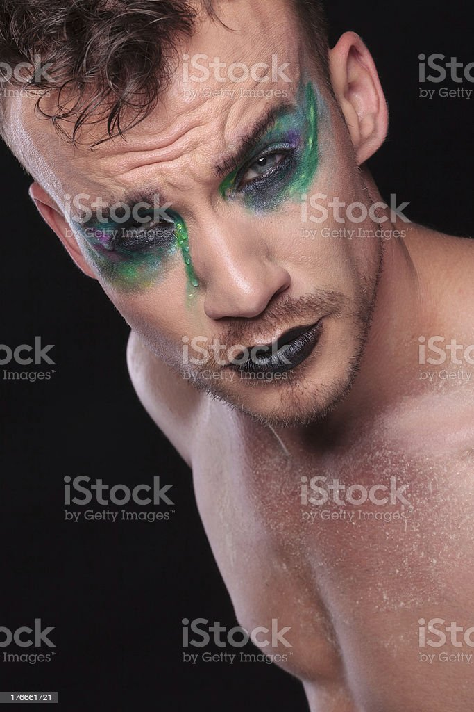 casual man with makeup on black background royalty-free stock photo