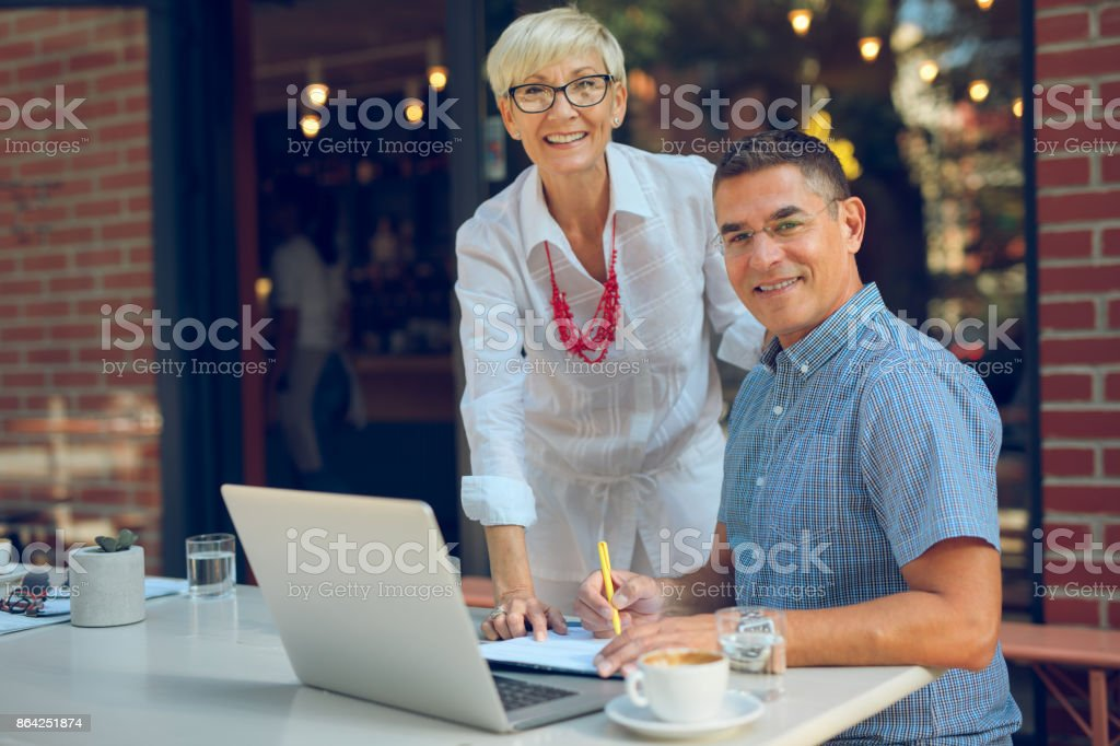 Casual mature business people working together on new ideas royalty-free stock photo
