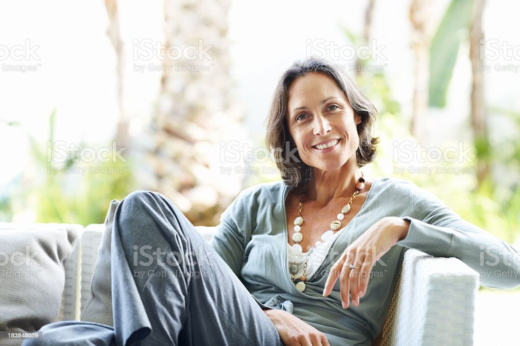 Casual, mature woman relaxing at home stock photo