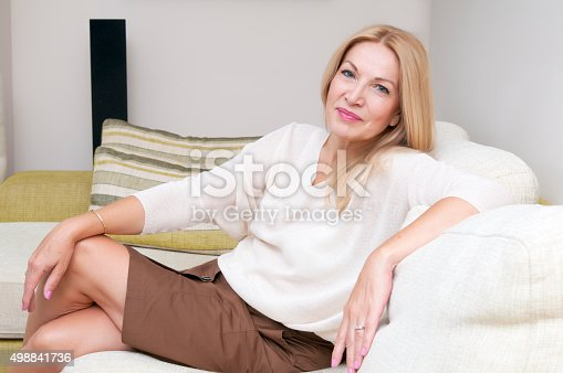 Casual Mature Woman Relaxing At Home Smiling Stock Photo  More Pictures Of 2015  Istock-1276