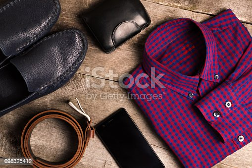istock Casual mens fashion and outfits on the wooden table, flat lay, top view 698325412