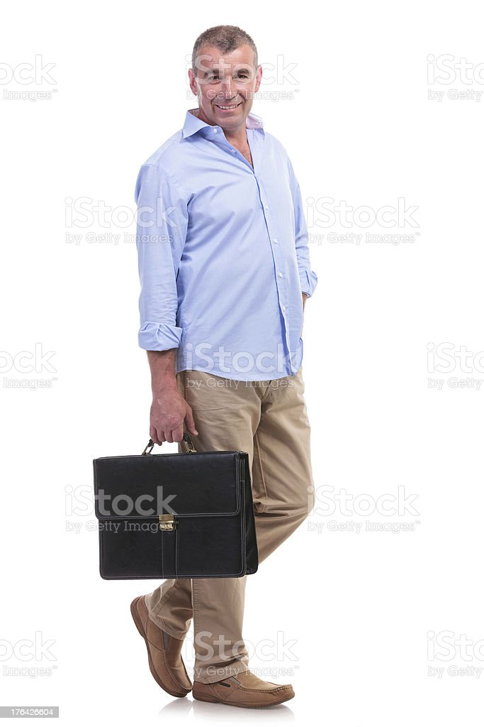 casual middle aged man carries briefcase royalty-free stock photo