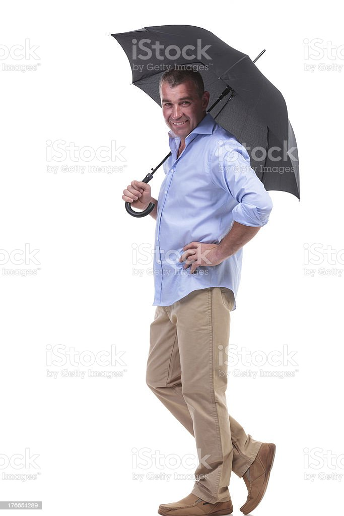 casual middle aged man under umbrella royalty-free stock photo