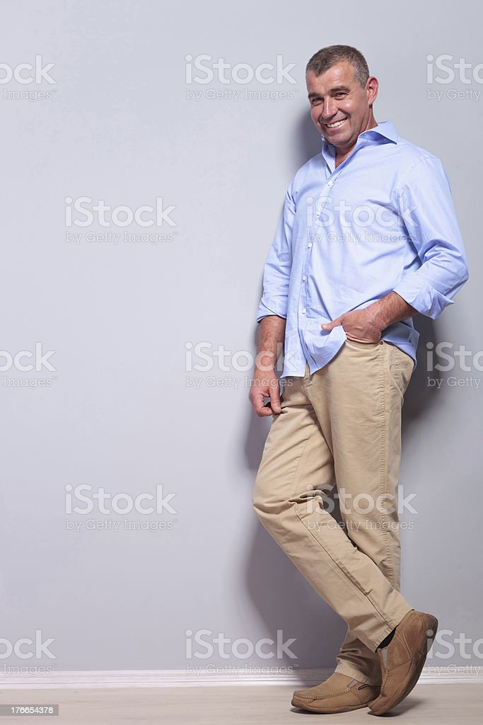 casual old man stands with hand in pocket royalty-free stock photo