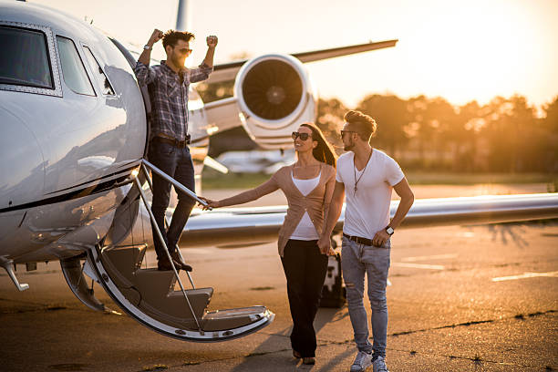 Casual people and private airplane stock photo