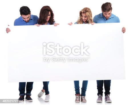 istock casual people holding and looking at a blank board 482021777