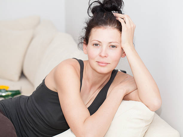 Casual portrait of a beautiful young woman indoor stock photo