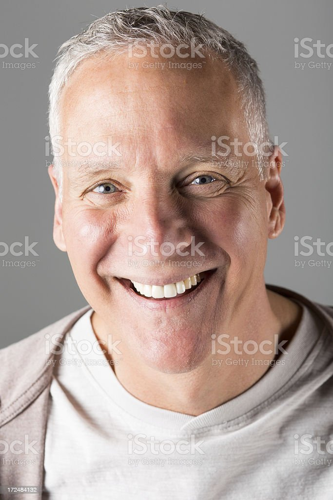 Casual portrait of grey haired middle age man, smiling royalty-free stock photo
