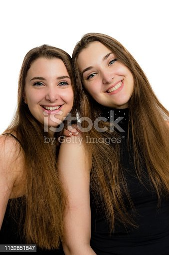 istock Casual portrait of pretty teen girls on white background 1132851847