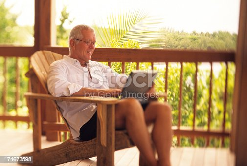 istock Casual retired man doing business 174673598
