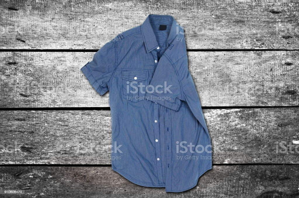 Casual shirt on the wooden background stock photo