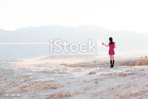 Casual spacegirl firing a laser gun