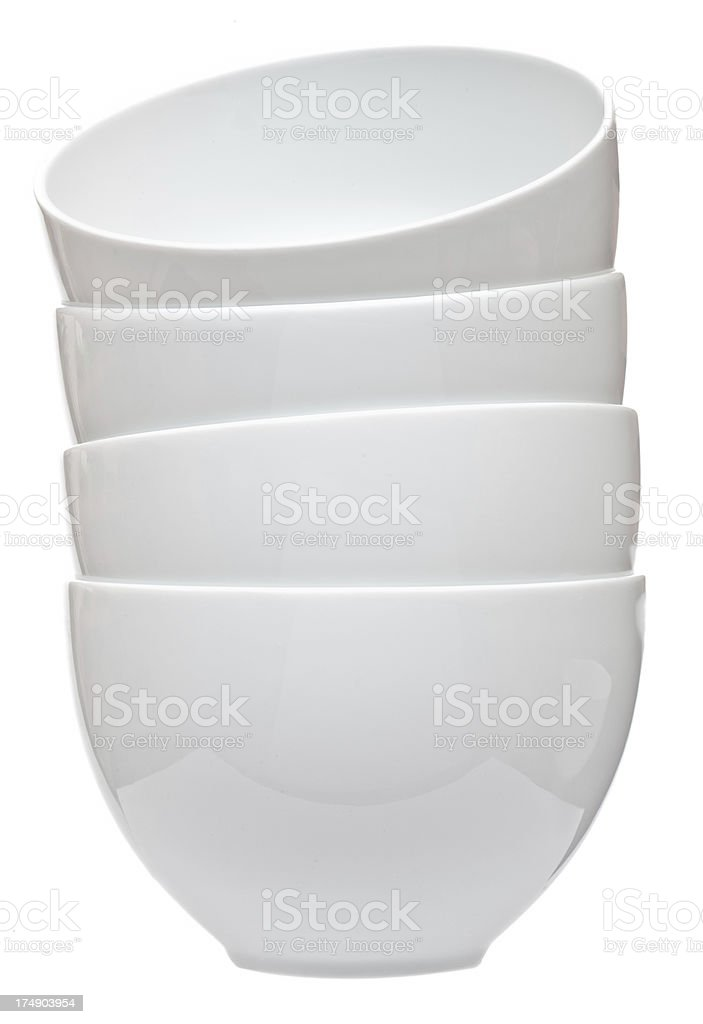 Casual stack of four white ceramic bowls royalty-free stock photo