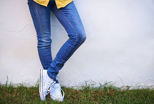 Casual style Cropped shot of a young woman standing outside skinny jeans stock pictures, royalty-free photos & images