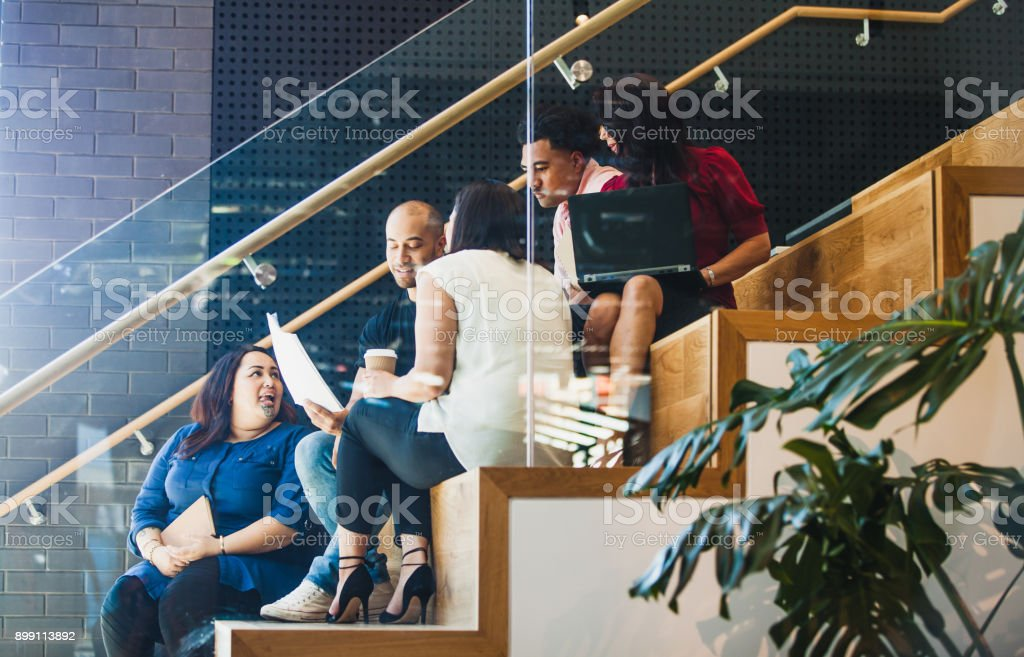 Casual team meeting side view. stock photo