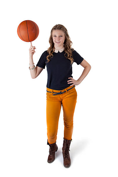 Casual Teenage Girl With Basketball Balancing On Her Finger stock photo