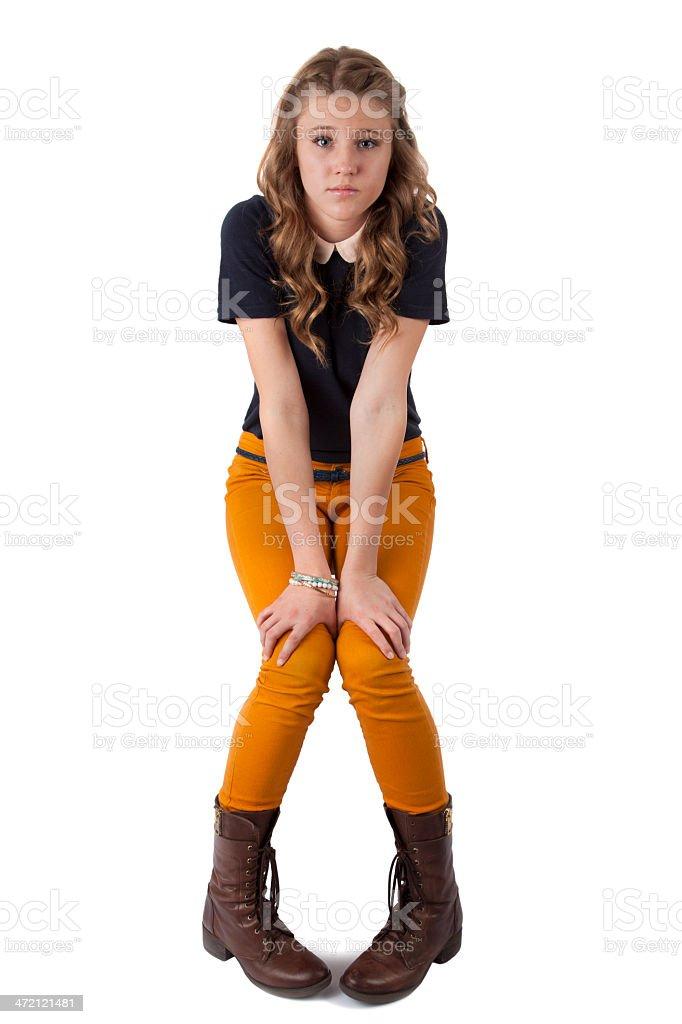 Casual Teenage Girl With Hand on Knees stock photo