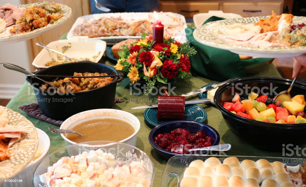 Casual Thanksgiving Dinner with Multiple Plates stock photo
