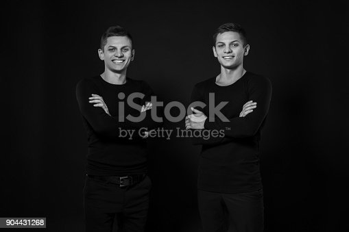 istock Casual twin brothers. Studio shot. Black and white photography 904431268