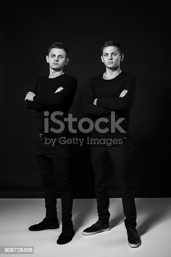 istock Casual twin brothers. Studio shot. Black and white photography 906728458