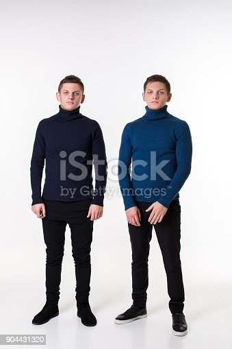istock Casual twin brothers. Studio shoton a white background 904431320