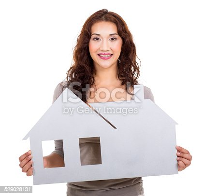 1047558948 istock photo casual woman holding paper house 529028131