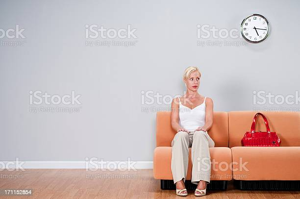 Casual Woman In Waiting Room Stock Photo - Download Image Now