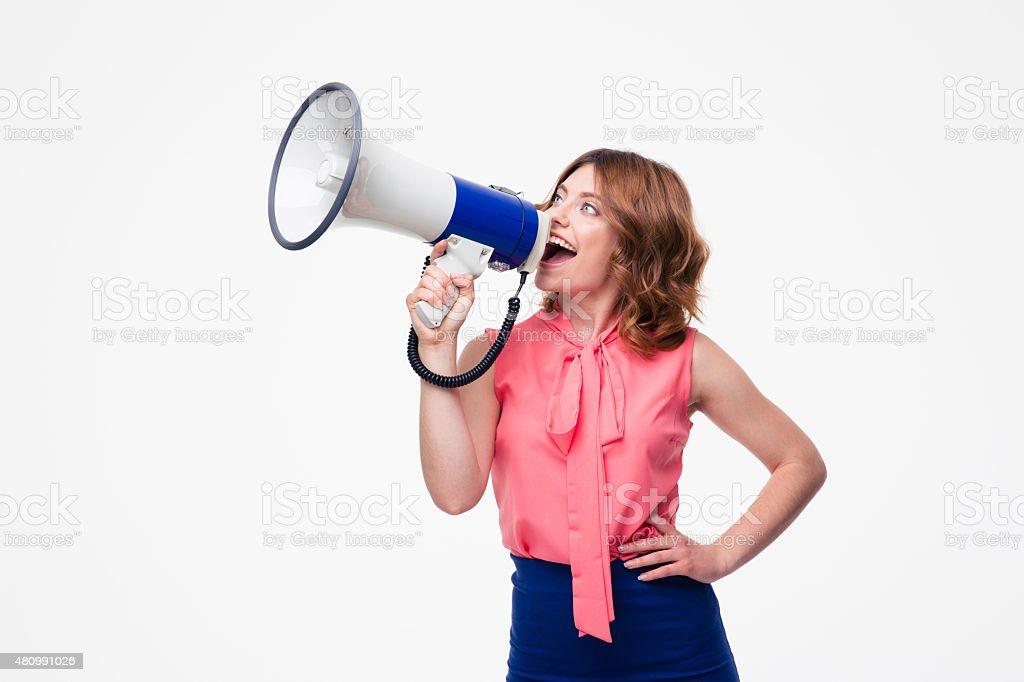 Casual woman screaming in loudspeaker stock photo