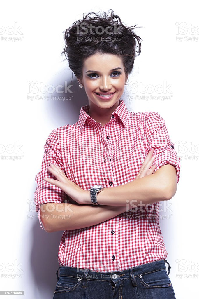 casual woman smiling with hands crossed royalty-free stock photo