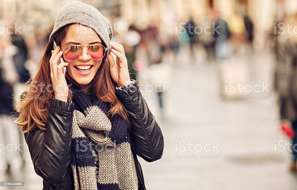 Casual woman talking on mobile phone royalty-free stock photo