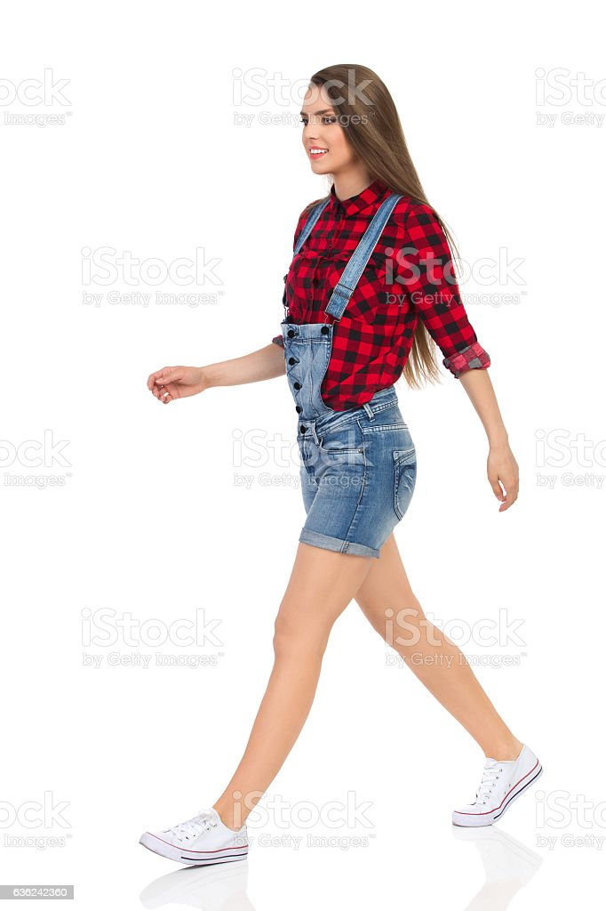Casual Woman Walking Side View Isolated stock photo