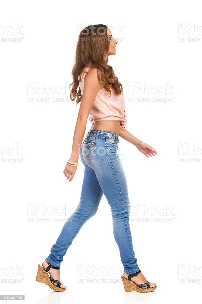 Casual Woman Walking Side View stock photo