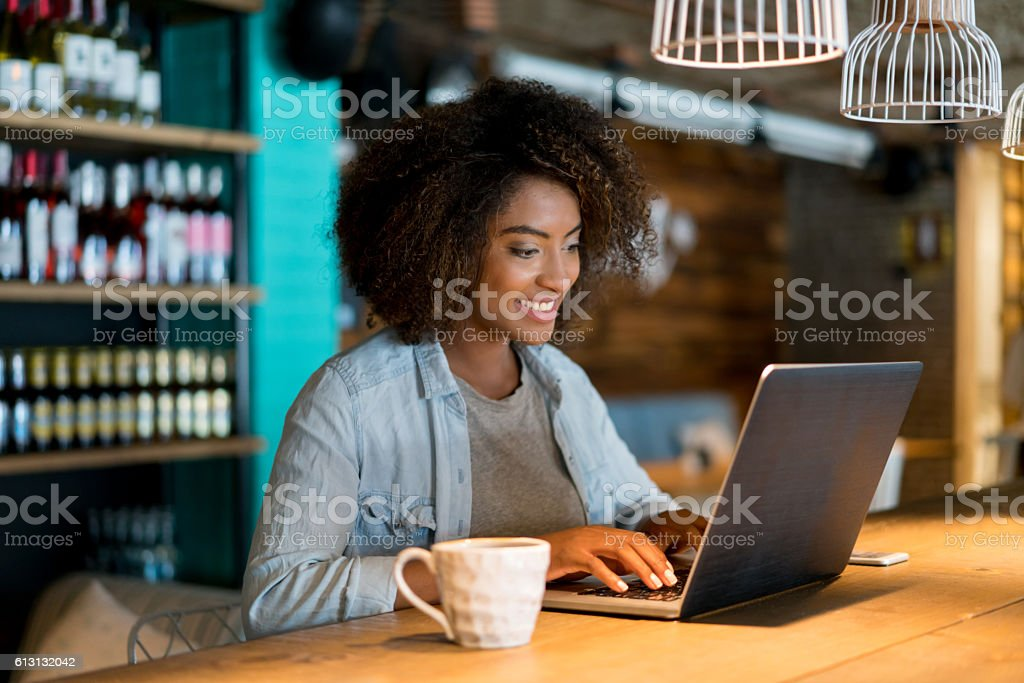 Casual woman working at a cafe stock photo