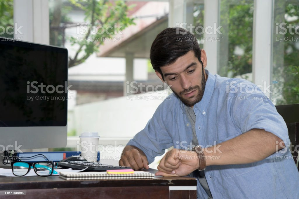 casual working man work at private place like home in front of...