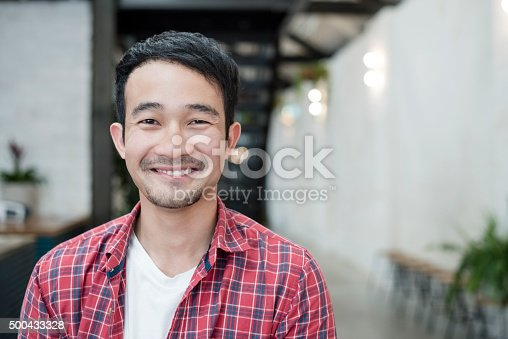 istock Casual young Asian businessman smiling towards camera, portrait 500433328