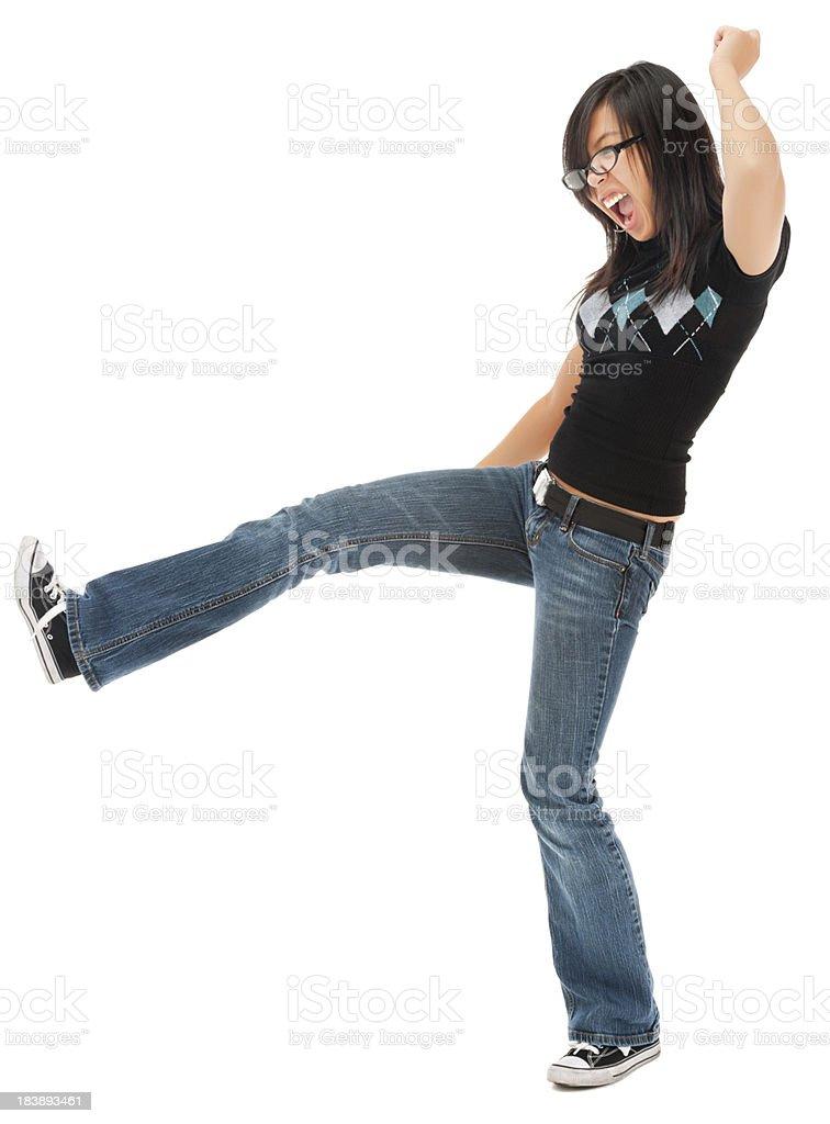 Casual Young Asian Woman Kicking stock photo