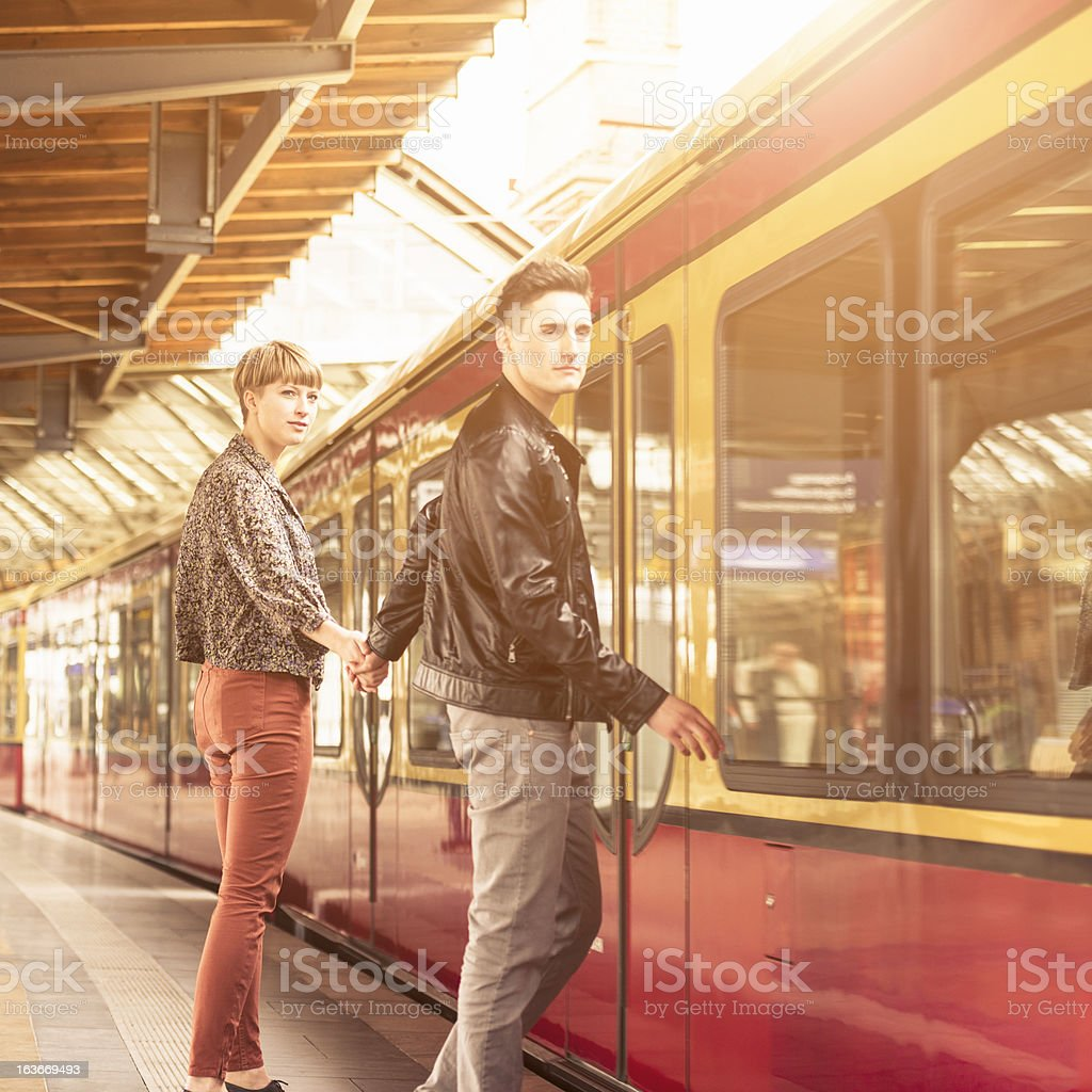 Casual young couple waiting the train in berlin royalty-free stock photo