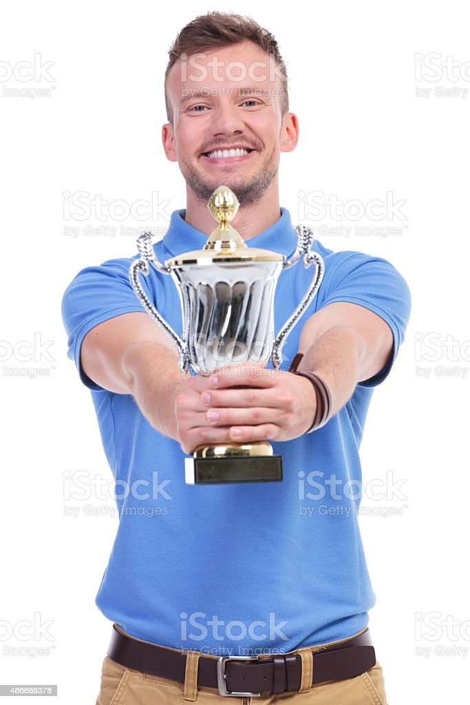 casual young man holds his trophy stock photo