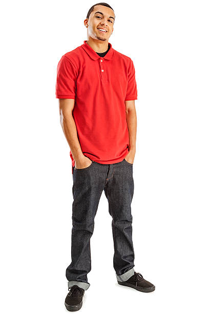 Casual Young Man on White Photo of a young African Amercan male in red shirt and blue jeans; isolated on white. red shirt stock pictures, royalty-free photos & images
