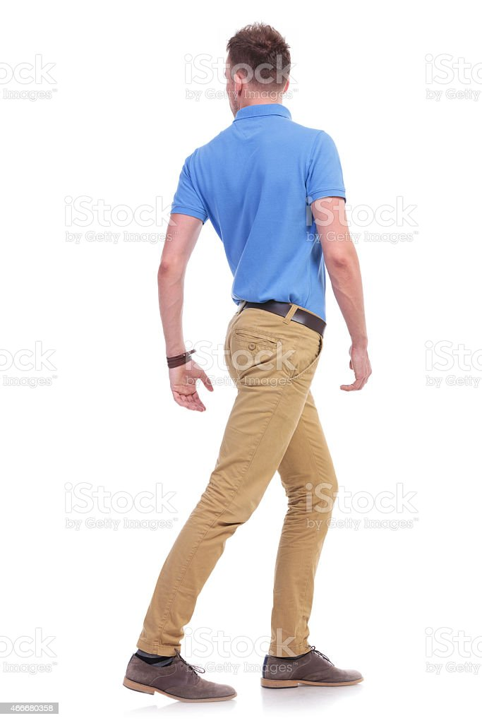 casual young man turns his back stock photo