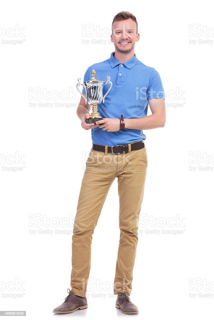 casual young man with a trophy stock photo