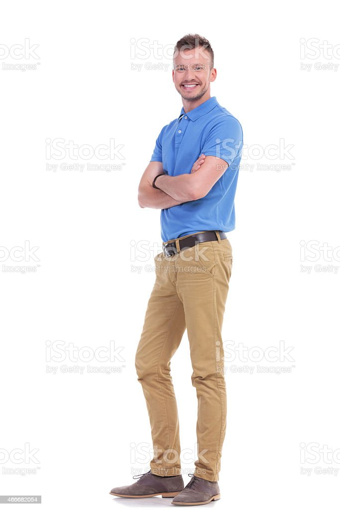 casual young man with hands folded stock photo