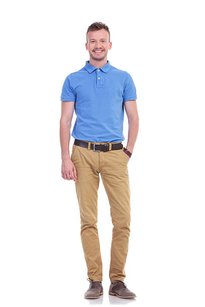 casual young man with one hand in his pocket stock photo