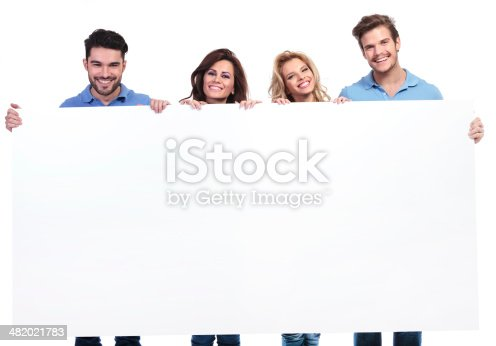 istock casual young people showing a big blank banner and smile 482021783