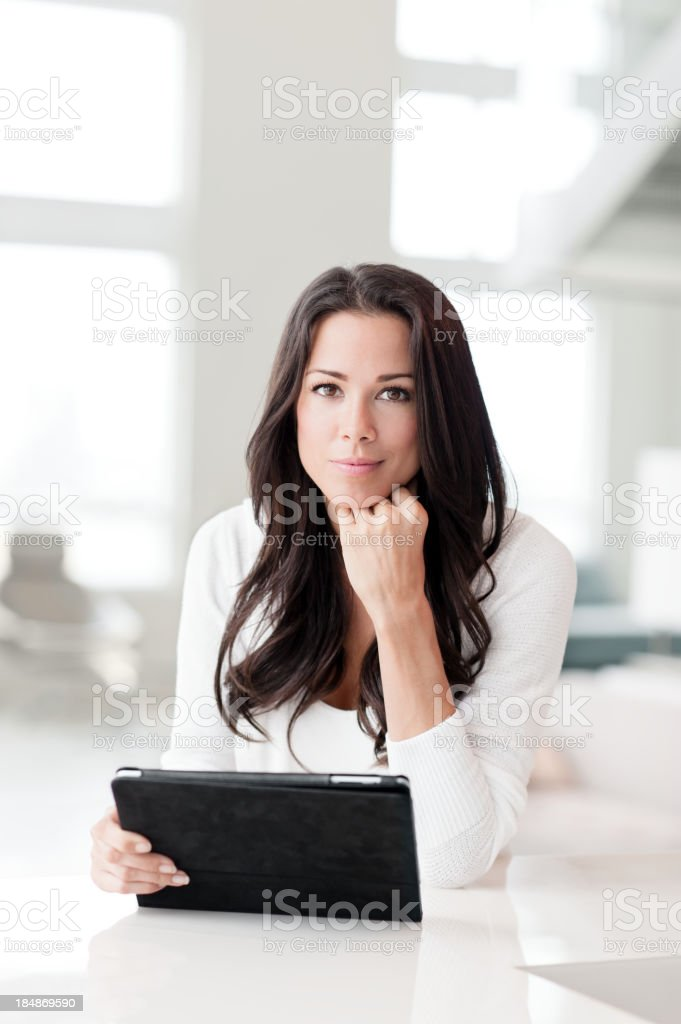 Casual Young Woman with Digital Tablet in Showcase Home royalty-free stock photo
