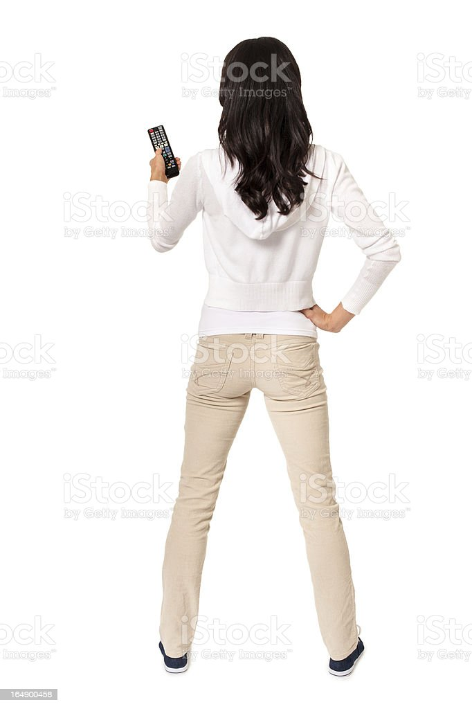 Casual Young Woman with TV Remote Control on White royalty-free stock photo