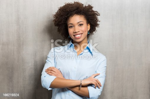 istock Casually dressed businesswoman on gray stained background 166219324