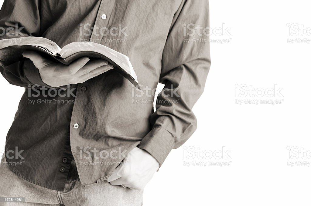 Casually Dressed Christian Man Holding Open Bible Casually-dressed Christian guy holding his open Bible. 20-24 Years Stock Photo